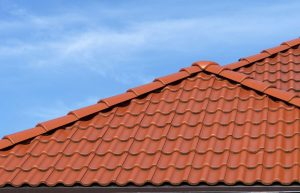 Roof peak with brown roof tiles