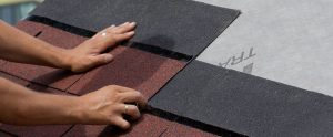 Roofing Professional installing new shingles on a roof