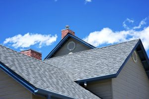 House Roof - Roofing Works. Cloudy Blue Sky. Frisco Building Style.