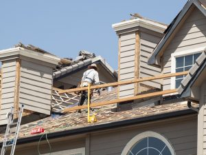 Roof repairs of an apartment building in Colorado.