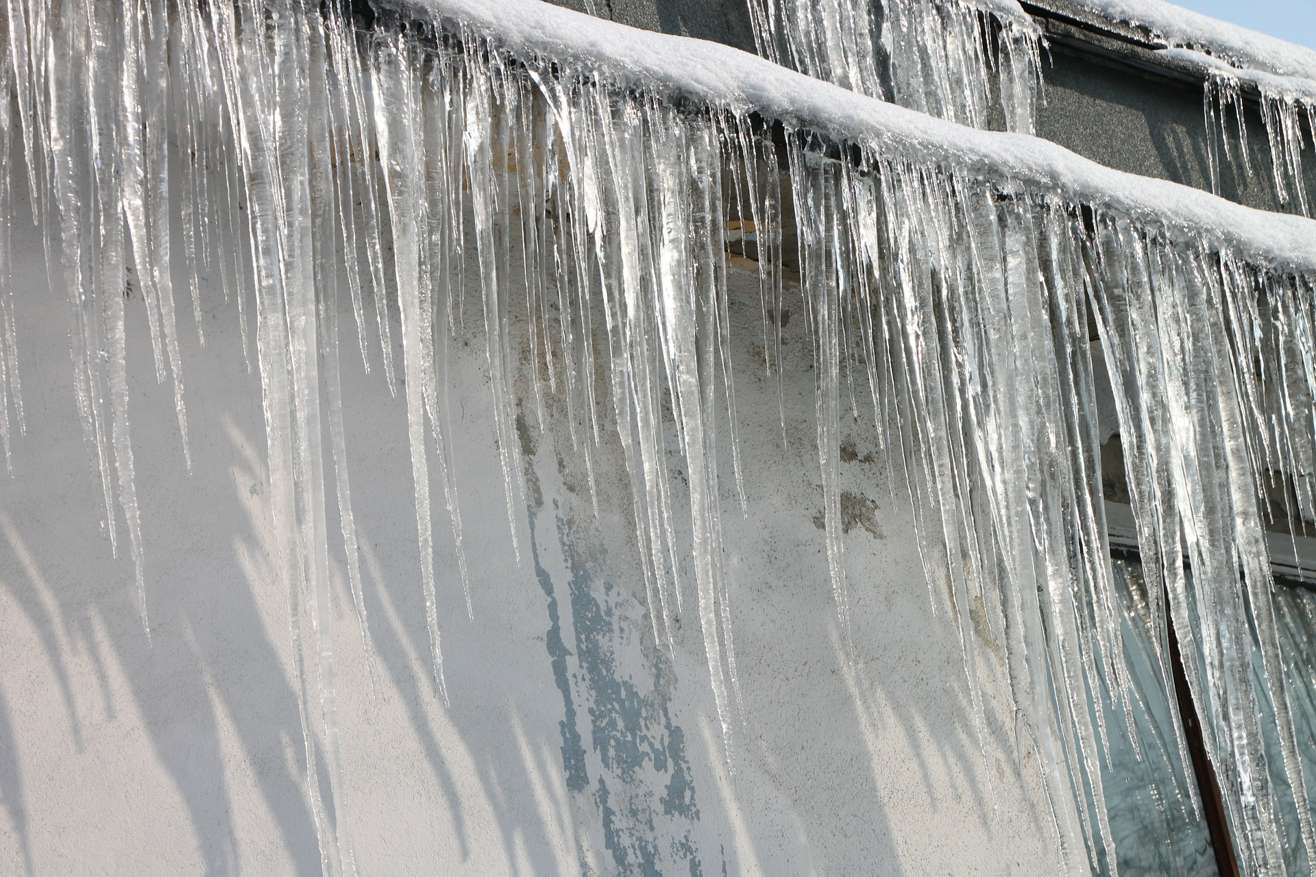 ice dams and icicles formed on a building